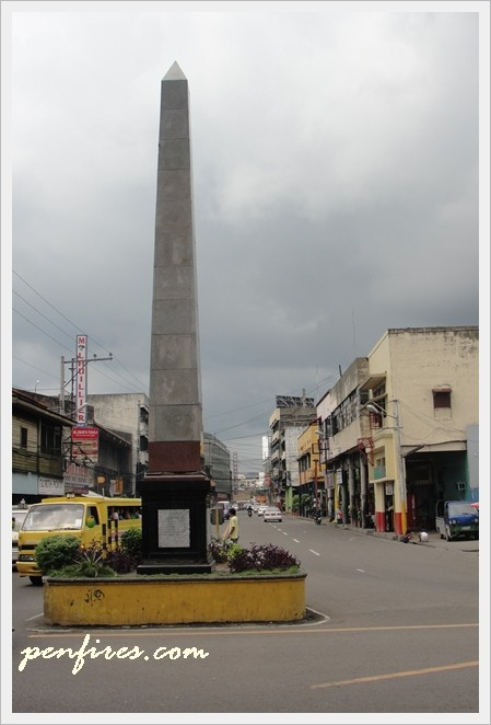 Colon street heritage marker and obelisk