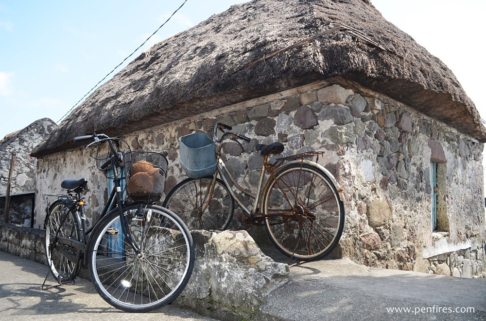Bicycles and stone houses